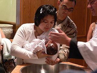 Baptême d'un enfant, photo Carlo Cabanilla